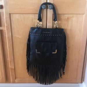 Black leather Bebe purse with studs and fringe
